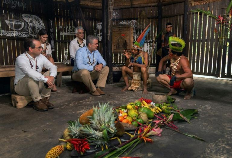 Colombian President Ivan Duque (C-L) meeting with indigenous leaders before a summit on protecting the Amazon in Leticia, Colombia, on September 6, 2019