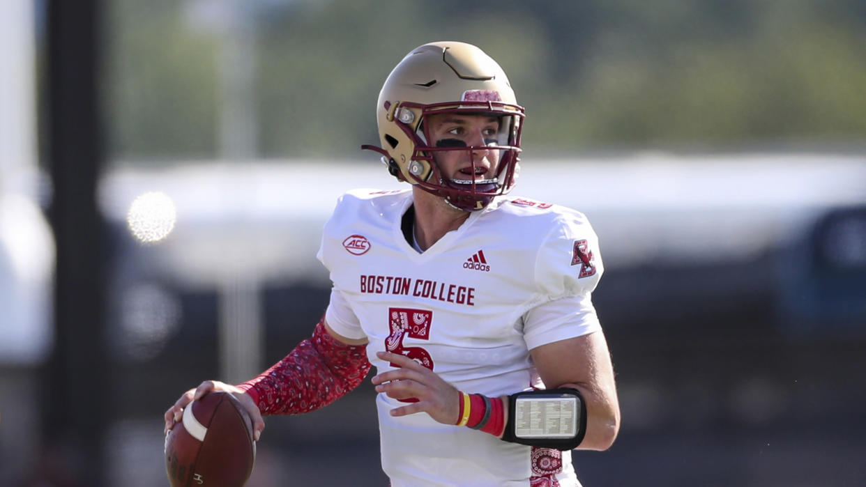 Boston College Eagles quarterback Phil Jurkovec (5) looks to pass during an NCAA football game against the University of Massachusetts Minutemen on Saturday, Sept 11, 2021, in Amherst, Mass. (AP Photo/Damian Strohmeyer)