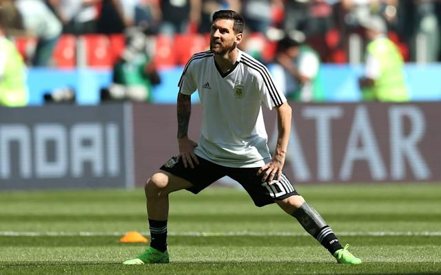 <p>Lionel Messi warms up as he looks to measure up to Ronaldo's Friday night performance </p>