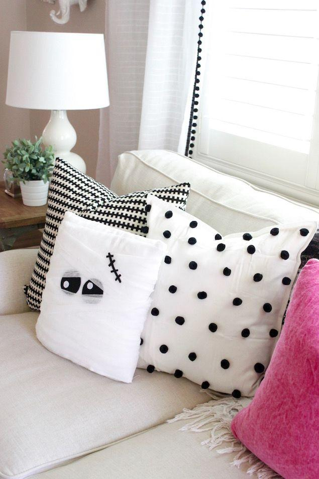 """<p>Here's proof that your house can still stay minimalistic and chic during one of the more extravagant holidays. </p><p><em><a href=""""http://eighteen25.com/2016/09/diy-mummy-pillow/"""" rel=""""nofollow noopener"""" target=""""_blank"""" data-ylk=""""slk:Get the tutorial at Eighteen 25 »"""" class=""""link rapid-noclick-resp"""">Get the tutorial at Eighteen 25 »</a></em> </p>"""