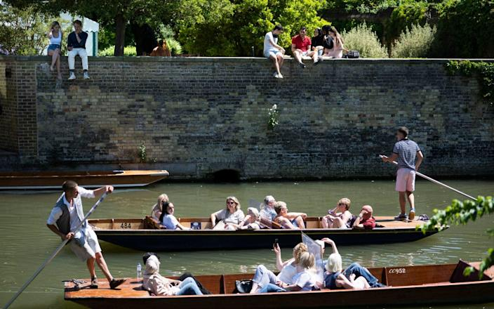 Good weather means a busy time for the city's punts on the River Cam - David Rose