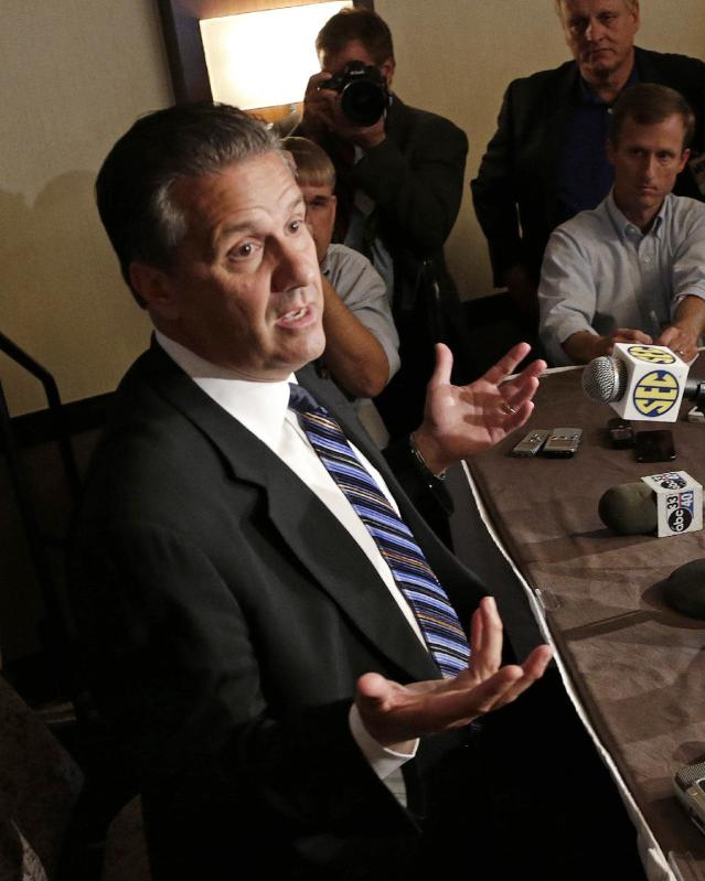 Kentucky men's oach John Calipari talks with reporters during the Southeastern Conference NCAA college basketball media day in Birmingham, Ala., Wednesday, Oct. 16, 2013. (AP Photo/Dave Martin)
