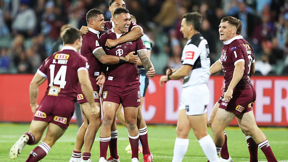 Queensland players, pictured here celebrating after winning the State of Origin opener.