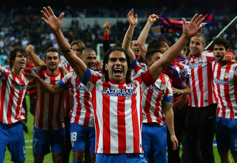 Atletico de Madrid's Radamel Falcao from Colombia, center, and teammates celebrate defeating Real Madrid in the Copa del Rey final soccer match at the Santiago Bernabeu stadium in Madrid, Spain, Friday, May 17, 2013. (AP Photo/Andres Kudacki)