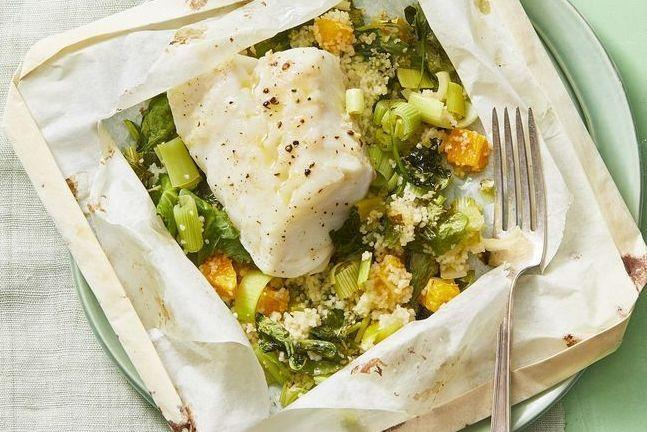 """<p>Steamed fish and plain veggies used to be seen as one of the most basic healthy meals. This lunch puts a flavorful spin on the classic meal, and the parchment paper guarantees an easy cleanup. <br></p><p><em><a href=""""https://www.womansday.com/food-recipes/a30392806/cod-in-parchment-with-orange-and-leek-couscous-recipe/"""" rel=""""nofollow noopener"""" target=""""_blank"""" data-ylk=""""slk:Get the Cod in Parchment with Orange-and-Leek Couscous recipe."""" class=""""link rapid-noclick-resp"""">Get the Cod in Parchment with Orange-and-Leek Couscous recipe.</a></em></p>"""