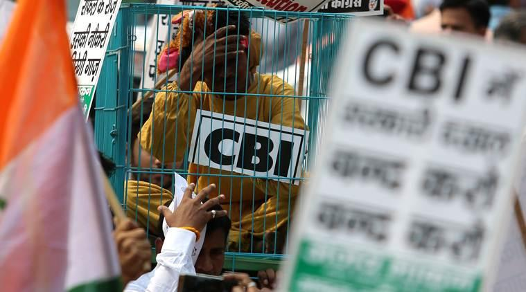 CBI caged parrot, congress protest against bjp, protest against removal of cbi director, rahul gandhi arrest, rahul gandhi protest, congress march, indian express