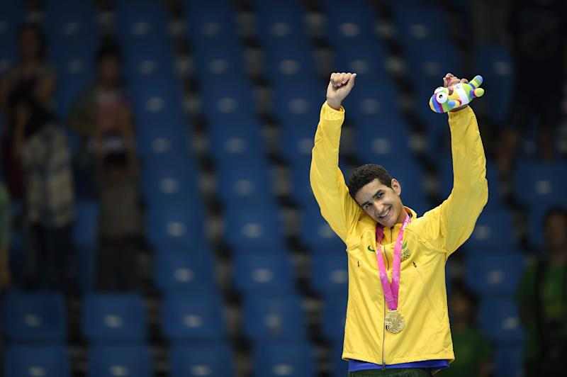 NANJING, CHINA - AUGUST 19: (CHINA OUT) Gold medalist Edival Marques Quirino Pontes of Brazil celebrates on the podium after the Taekwondo Men's -63kg final match on day three of the Nanjing 2014 Summer Youth Olympic Games at Nanjing International Expo Centre on August 19, 2014 in Nanjing, China. (Photo by VCG/VCG via Getty Images)