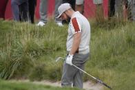 Team Europe's Tyrrell Hatton reacts after his bunker shot on the 18th hole during a four-ball match the Ryder Cup at the Whistling Straits Golf Course Saturday, Sept. 25, 2021, in Sheboygan, Wis. (AP Photo/Charlie Neibergall)