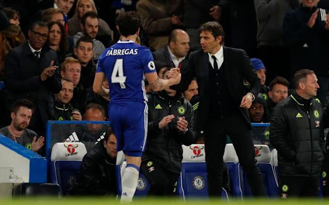 Antonio Conte congratulates Cesc Fabregas after a good performance - REUTERS