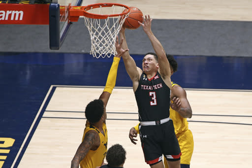Texas Tech guard Clarence Nadolny (3) shoots while defended by West Virginia forwards Jalen Bridges (2) and Derek Culver (1) during the second half of an NCAA college basketball game Monday, Jan. 25, 2021, in Morgantown, W.Va. (AP Photo/Kathleen Batten)