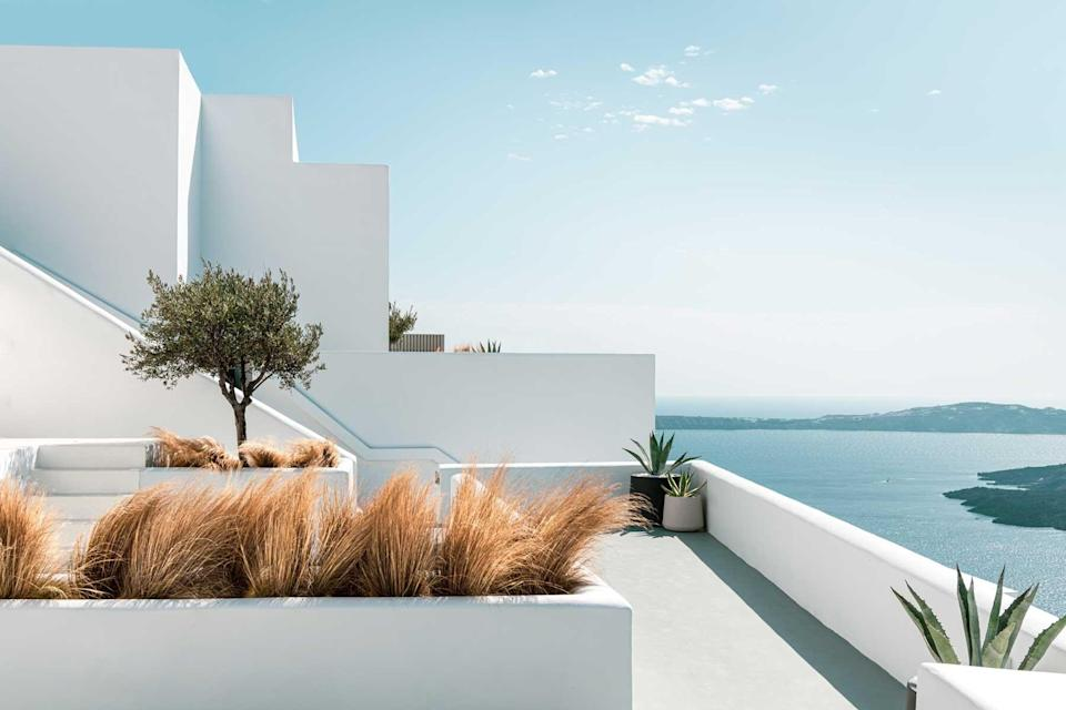 Whitewashed terrace of the Grace Hotel, voted one of the best hotels in the world