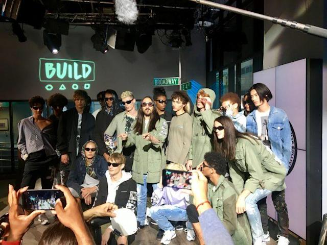 Steve Aoki poses with models before his Dim Mak Collection runway show. The clothes were Japan-meets-L.A. streetwear, with a touch of politics. (Photo: Yahoo Style)