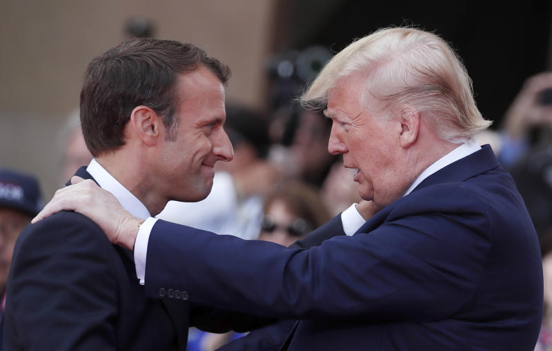 """FILE - In this Thursday, June 6, 2019 file photo French President Emmanuel Macron, left, meets U.S President Donald Trump during a ceremony to mark the 75th anniversary of D-Day at the Normandy American Cemetery in Colleville-sur-Mer, Normandy, France. President Donald Trump promised on Friday July 26, 2019 to retaliate against France for adopting a pioneering tax on internet giants like Google, Amazon and Facebook. Trump said referring to French President Emmanuel Macron: """"We will announce a substantial reciprocal action on Macron's foolishness shortly.""""(Ian Langsdon/POOL via AP, File)"""