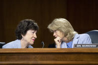 Sen. Susan Collins, R-Maine, left, and Sen. Lisa Murkowski, R-Alaska, talk during a Senate Appropriations Committee hearing to examine proposed budget estimates and justification for fiscal year 2022 for the Department of Defense in Washington on Thursday, June 17, 2021. (Caroline Brehman/Pool via AP)