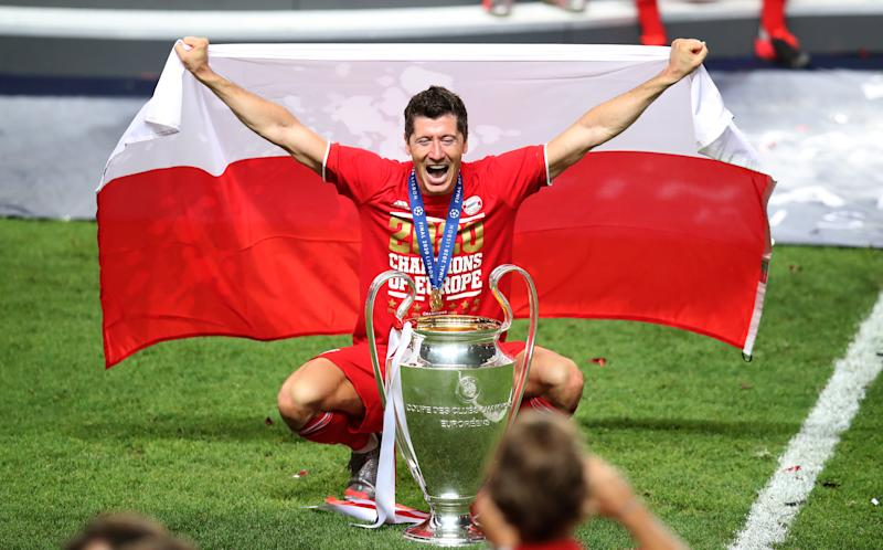 LISBON, PORTUGAL - AUGUST 23: Robert Lewandowski of Bayern Muenchen celebrates with the trophy during the UEFA Champions League Final match between Paris Saint-Germain and Bayern Munich at Estadio do Sport Lisboa e Benfica on August 23, 2020 in Lisbon, Portugal. (Photo by M. Donato/Getty Images for FC Bayern)
