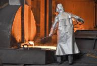 FILE - In this April 27, 2018 photo a worker controls iron at the Thyssenkrupp steel factory in Duisburg, Germany. The European Union and the United States have decided to temporarily suspend measures at the heart of a steel tariff dispute that is seen as one of the major trade issues dividing the two sides. The issue goes back to the 2018 tariffs that then-President Donald Trump slapped on EU steel and aluminum, which enraged Europeans and other allies by calling their metals a threat to U.S. national security. (AP Photo/Martin Meissner, File)