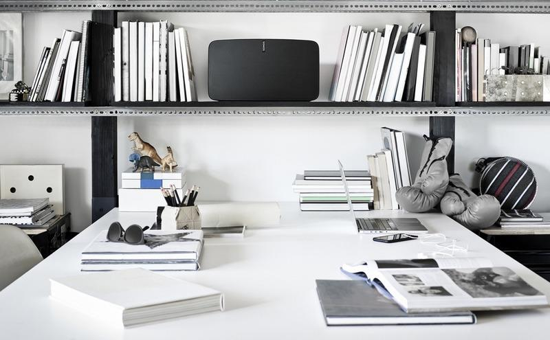 """<p>For something so simple to set up, so easy to find a spot for, this <a href=""""http://www.sonos.com/shop/play5"""">Sonos Play:5</a> will spoil him for all other speakers. It sounds fantastic, filling the room with rich sound. Its new TunePlay software automatically adjusts the speaker to the room. The Sonos app lets him tap into all manner of music streaming services (Pandora, Tidal, Rhapsody, SiriusXM, and more). The music plays over Wi-Fi, so he won't be irritated by Bluetooth connection problems. And he can set alarms to soothe him to sleep at night and wake him up with his favorite music in the morning. <i>(<a href=""""http://www.sonos.com/shop/play5"""">Sonos</a>, $500)</i></p>"""