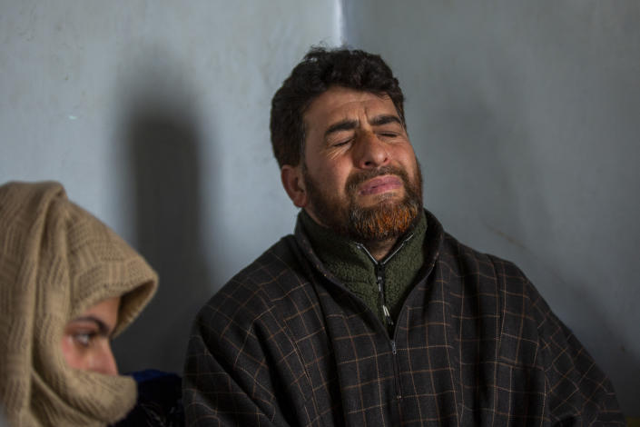 "Mushtaq Ahmad Wani, father of 16-year-old Athar Mushtaq, grieves while talking to Associated Press in Bellow, south of Srinagar, Indian controlled Kashmir, Tuesday, Jan. 5, 2021. On the last week of 2020, Indian government forces killed Athar and two other young men during a controversial gunfight on the outskirts of the Indian-controlled Kashmir's main city. Police did not call them anti-India militants but ""hardcore associates of terrorists."" They later buried them at a graveyard in a remote mountainous tourist resort miles away from their ancestral villages. Athar was the latest Kashmiri to be buried in a far-off graveyard after Indian authorities in a new controversial policy in 2020 started to consign blood-soaked bodies of scores of Kashmiri suspected rebels to unmarked graves, denying the mourning families a proper funeral and a burial. (AP Photo/ Dar Yasin)"