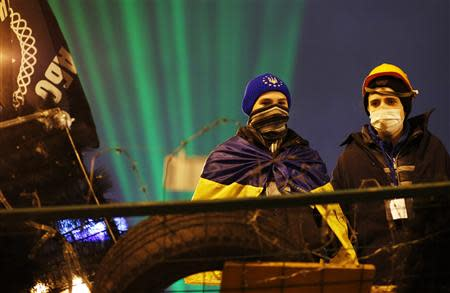 Pro-European integration protesters stand on a barricade during a rally at Independence Square in Kiev December 17, 2013. REUTERS/Marko Djurica
