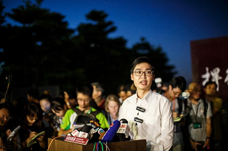 Andy Chan (C), leader of the pro-independence Hong Kong National Party and a disqualified candidate of upcoming elections, speaks at the rally in Hong Kong on August 5, 2016 (AFP Photo/Anthony Wallace)