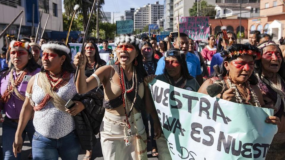 Nemonte Nenquimo leads a protest against the auctioning off of oil concessions
