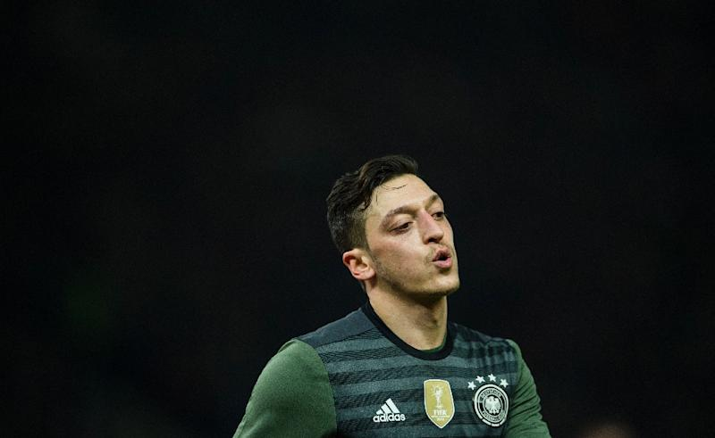 President Recep Tayyip Erdogan said he had spoken toTurkish-origin football star Mesut Ozil after his decision to quit the German team in protest at racism (AFP Photo/ODD ANDERSEN)