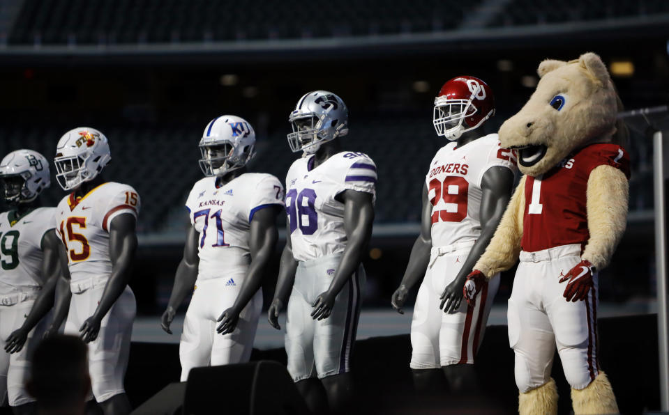 Oklahoma mascot Boomer poses to match the team uniforms on stage on the first day of Big 12 Conference NCAA college football media days Monday, July 15, 2019, at AT&T Stadium in Arlington, Texas. (AP Photo/David Kent)