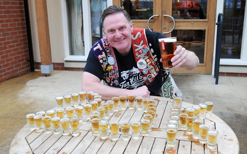 Pete Hill, a member of the Black Country Ale Tairsters, drinks a pint of Marston's 61 Deep pale ale  - Matthew Cooper/PA