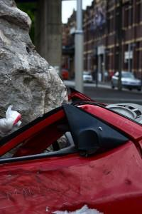 Car crushed by boulder