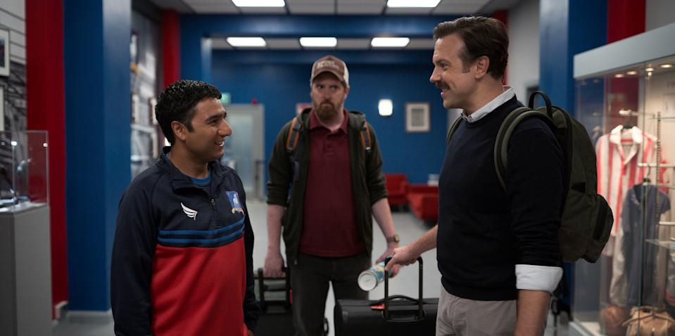"""Nick Mohammed, Brendan Hunt, and Jason Sudeikis in """"Ted Lasso,"""" premiering globally on Friday, August 14, on Apple TV+."""