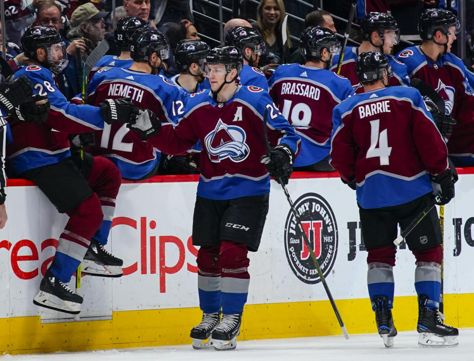 Colorado Avalanche center Nathan MacKinnon (29) celebrates a goal against the Buffalo Sabres with teammates on the bench during the second period of an NHL hockey game Saturday, March 9, 2019, in Denver. (AP Photo/Jack Dempsey)