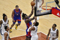Detroit Pistons center Isaiah Stewart (28) shoots against Memphis Grizzlies center Xavier Tillman (2) during the second half of an NBA basketball game Friday, Feb. 19, 2021, in Memphis, Tenn. (AP Photo/Brandon Dill)