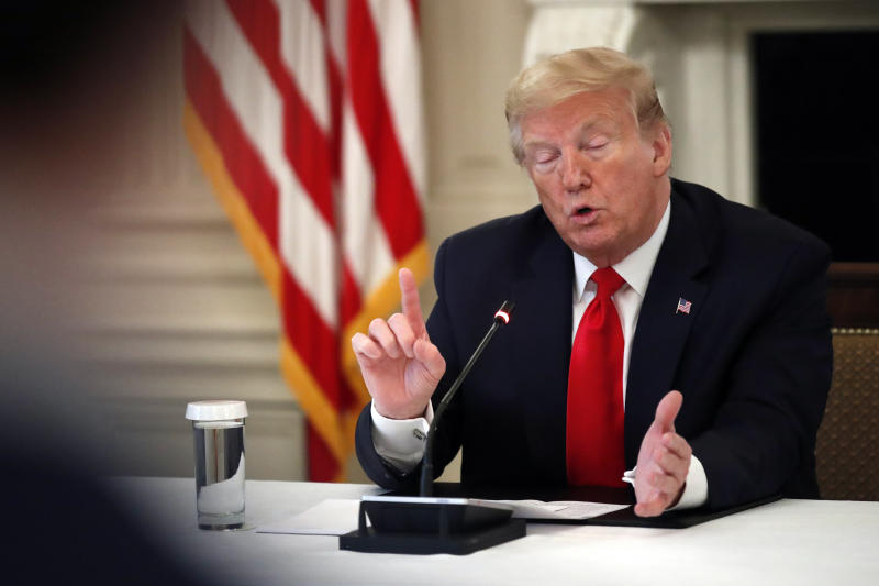 President Donald Trump speaks about reopening the country, during a roundtable with industry executives, in the State Dinning Room of the White House, Wednesday, April 29, 2020, in Washington. (AP Photo/Alex Brandon)