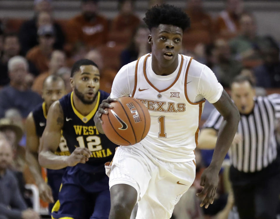 Texas guard Andrew Jones receives clearance to enroll in web-based coursework this summer. He remains recovering from leukemia.