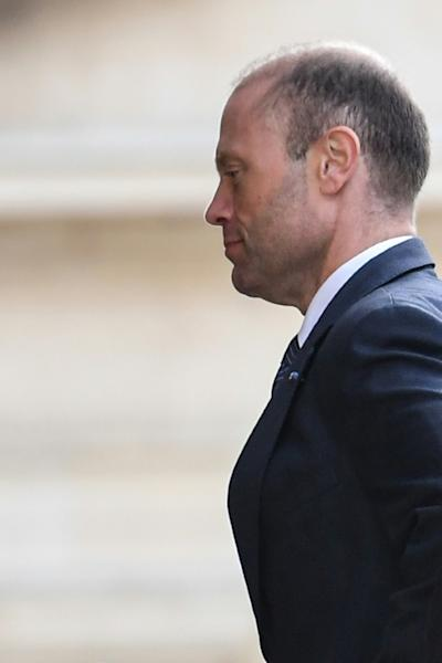 Malta's Prime Minister Joseph Muscat, seen here arriving at his office at the Castille Palace on Wednesday, has said he will quit next month