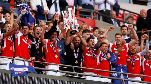 "Soccer Football - League One Play-Off Final - Rotherham United v Shrewsbury Town - Wembley Stadium, London, Britain - May 27, 2018 Rotherham celebrate winning the League One Play-Off Final with the trophy Action Images/Jason Cairnduff EDITORIAL USE ONLY. No use with unauthorized audio, video, data, fixture lists, club/league logos or ""live"" services. Online in-match use limited to 75 images, no video emulation. No use in betting, games or single club/league/player publications. Please contact your account representative for further details."