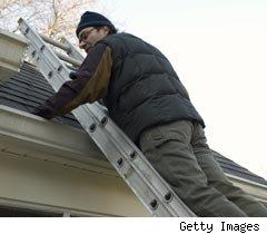 Man fixing tiles on roof