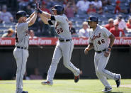 Detroit Tigers' Gordon Beckham, center, leaps as he celebrates with Jake Rogers, left, and Jeimer Candelario after Beckham hit a three-run home run during the eighth inning of the team's baseball game against the Los Angeles Angels in Anaheim, Calif., Wednesday, July 31, 2019. (AP Photo/Alex Gallardo)