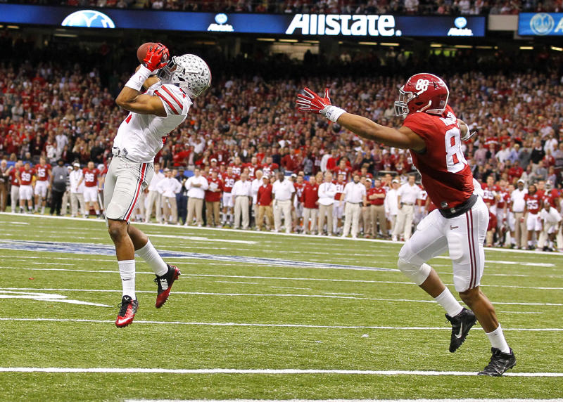 January 1, 2015: Ohio State Buckeyes defensive back Vonn Bell (11) makes an interception over Alabama Crimson Tide tight end O.J. Howard (88) during the Ohio State Buckeyes game versus the Alabama Crimson Tide in their College Football Playoff Semifinal played in the Allstate Sugar Bowl at the Mercedes-Benz Superdome in New Orleans, LA. The Ohio State Buckeyes won 42-35. (Photo by Todd Kirkland/Icon Sportswire/Corbis/Icon Sportswire via Getty Images)