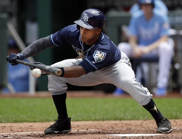 Tampa Bay Rays' Mallex Smith bunts for a single during the fourth inning of a baseball game against the Kansas City Royals at Kauffman Stadium in Kansas City, Mo., Wednesday, May 16, 2018. (AP Photo/Orlin Wagner)