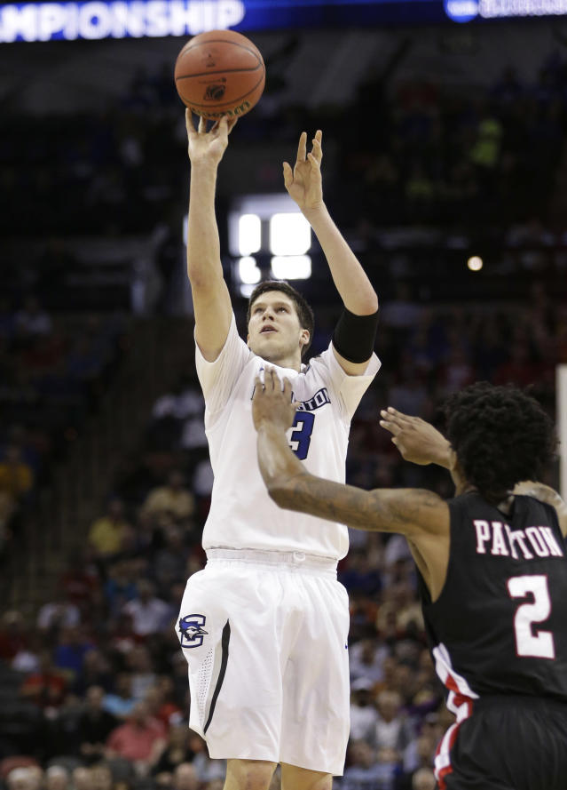 Creighton's Doug McDermott (3) shoots over Louisiana-Lafayette's Elfrid Payton (2) during the first half of a second-round game in the NCAA college basketball tournament Friday, March 21, 2014, in San Antonio. (AP Photo/David J. Phillip)