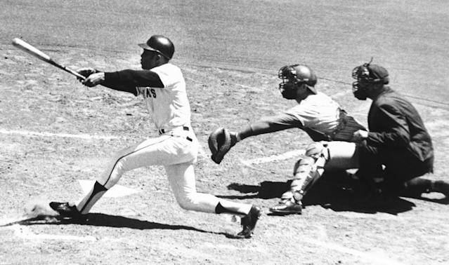 FILE - In this July 18, 1970, file photo, San Francisco Giants's Willie Mays connects with the 3,000th hit of his career, a single to left, in the second inning against the Montreal Expos at Candlestick Park in San Francisco. Expos catcher John Bateman waits for pitch from teammate Mike Wegener. The umpire is Mel Steiner. Candlestick Park, known for its bone-numbing winds, the Catch and the earthquake-rocked 1989 World Series. is officially closing after more than a half century of hosting sporting and cultural events. In a bow to historical symmetry, the Stick's finale will be a performance Thursday by Paul McCartney, 48 years after the Beatles' last scheduled concert lit up the venue. (AP Photo/Robert H. Houston, File)