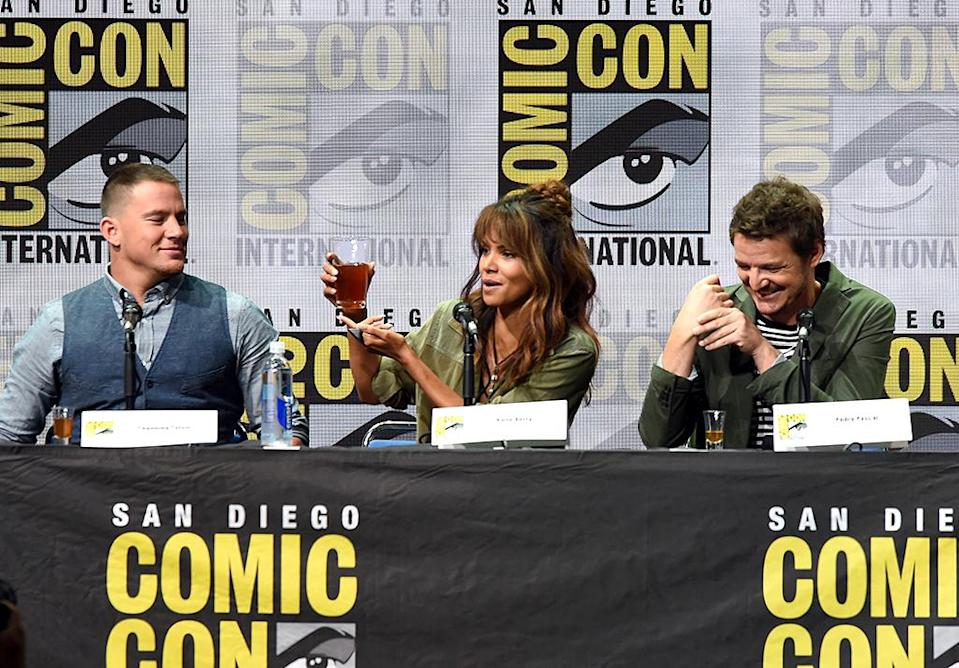 <p>Halle Berry raises a glass as costars Channing Tatum (left) and Pedro Pascal (right) look on at Fox Comic-Con panel on July 20, 2017, in San Diego. (Photo: Kevin Winter/Getty Images) </p>
