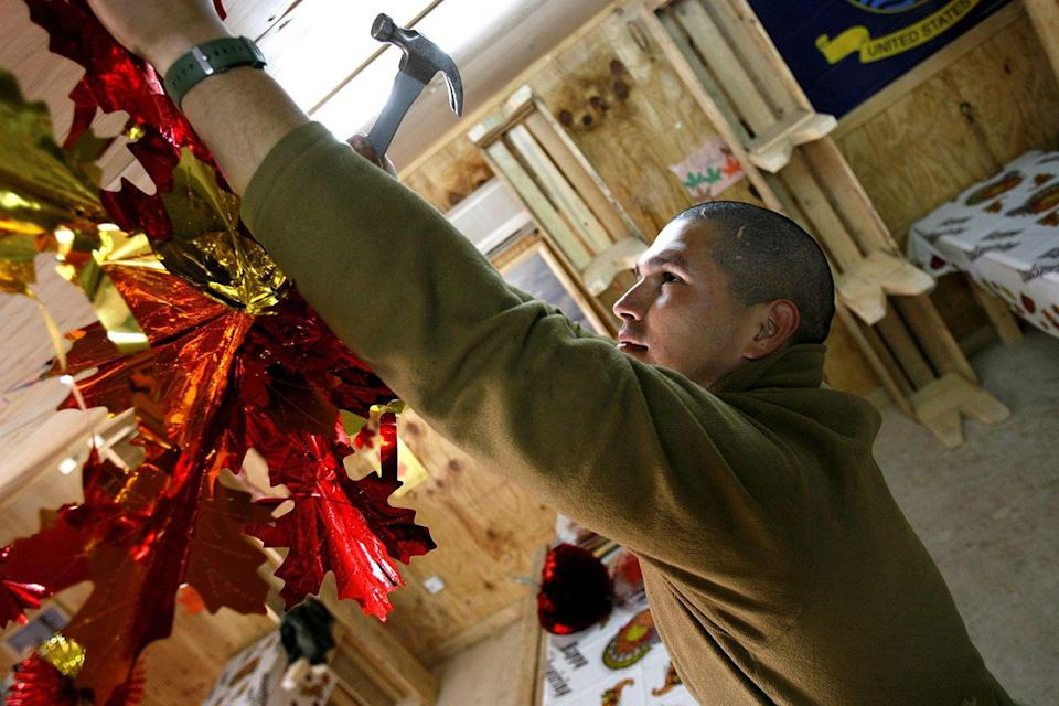 <p>The war in Iraq continued on, leading soldiers to put up festive decorations to bring a bit of home to their bases as they settled in for Thanksgiving dinner overseas. </p>