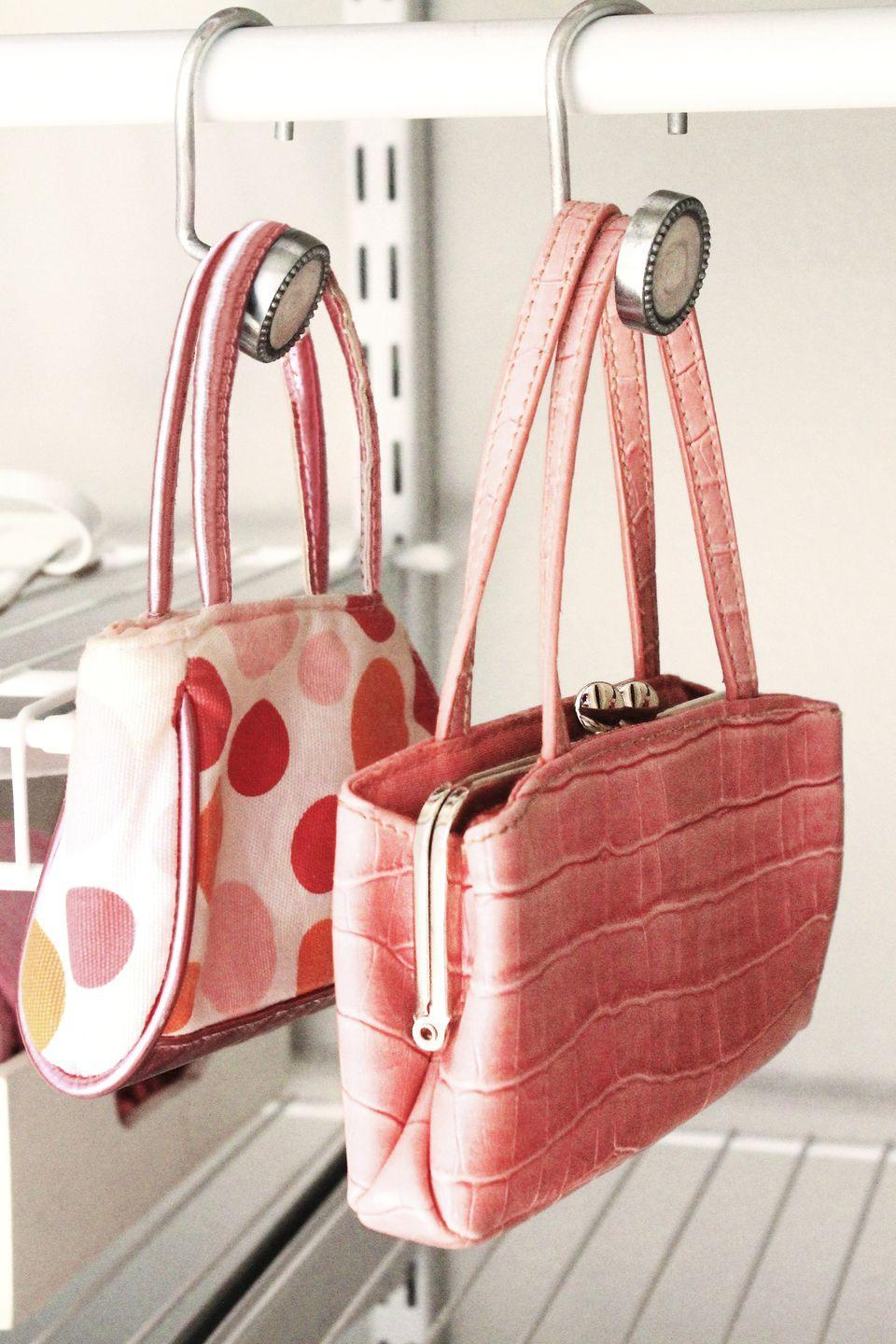 """<p>Bent to the side, these bathroom staples keep your bags off the floor.</p><p><em><a href=""""http://www.homemadebycarmona.com/princess-pink-closet/"""" rel=""""nofollow noopener"""" target=""""_blank"""" data-ylk=""""slk:See more at Homemade by Carmona »"""" class=""""link rapid-noclick-resp"""">See more at Homemade by Carmona »</a> </em></p>"""