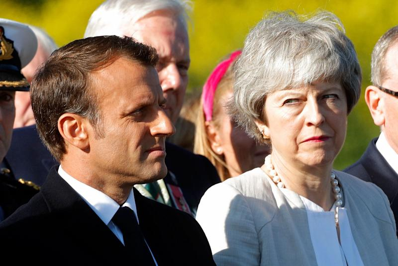 French President Emmanuel Macron and British Prime Minister Theresa May attend a ceremony to lay the first stone of the British Normandy Memorial in Ver-sur-Mer, Normandy, northwestern France, on June 6, 2019, as part of D-Day commemorations marking the 75th anniversary of the World War II Allied landings in Normandy. (Photo by PHILIPPE WOJAZER / POOL / AFP) (Photo credit should read PHILIPPE WOJAZER/AFP/Getty Images)