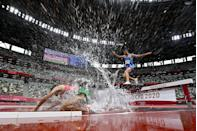 <p>Morocco's Mohamed Tindouft falls while running next to Italy's Ala Zoghlami while competing in the men's 3000m steeplechase heats.</p>