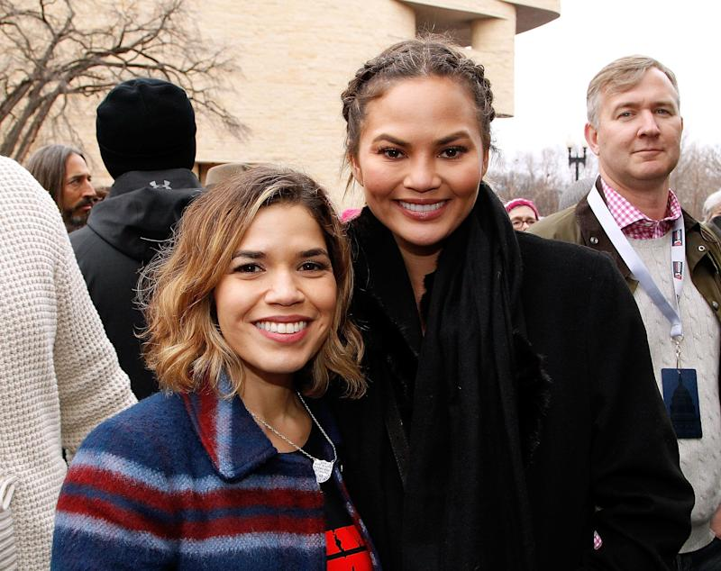America Ferrara and Chrissy Teigen pose for a photo at the Women's March on Washington, DC.