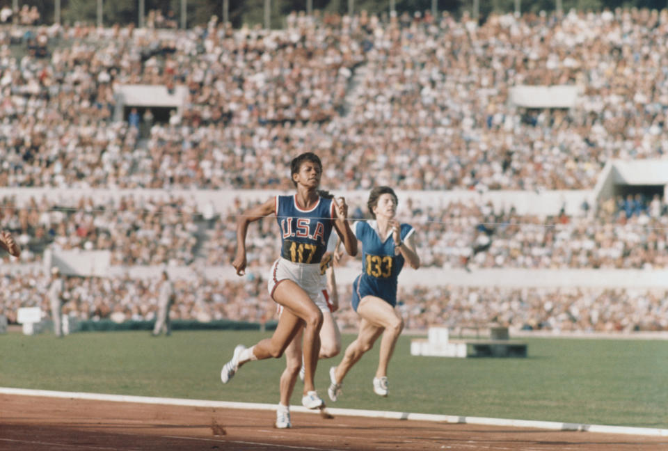 American Olympic sprinter Wilma Rudolph in the final steps of a race at the 1960 Summer Games. Rudolph, who couldn't walk without the use of braces until she was nine, won gold in the 100- and 200-meter run, and anchored the winning 400-meter relay team. (Photo by Jerry Cooke/Corbis via Getty Images)