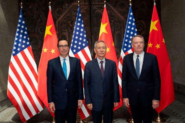 PHOTO: Chinese Vice Premier Liu He (C) with United States Trade Representative Robert Lighthizer (R) and Treasury Secretary Steven Mnuchin (L) pose for photos before holding talks at the Xijiao Conference Center in Shanghai, July 31, 2019. (Ng Han Guan/AFP/Getty Images, FILE)